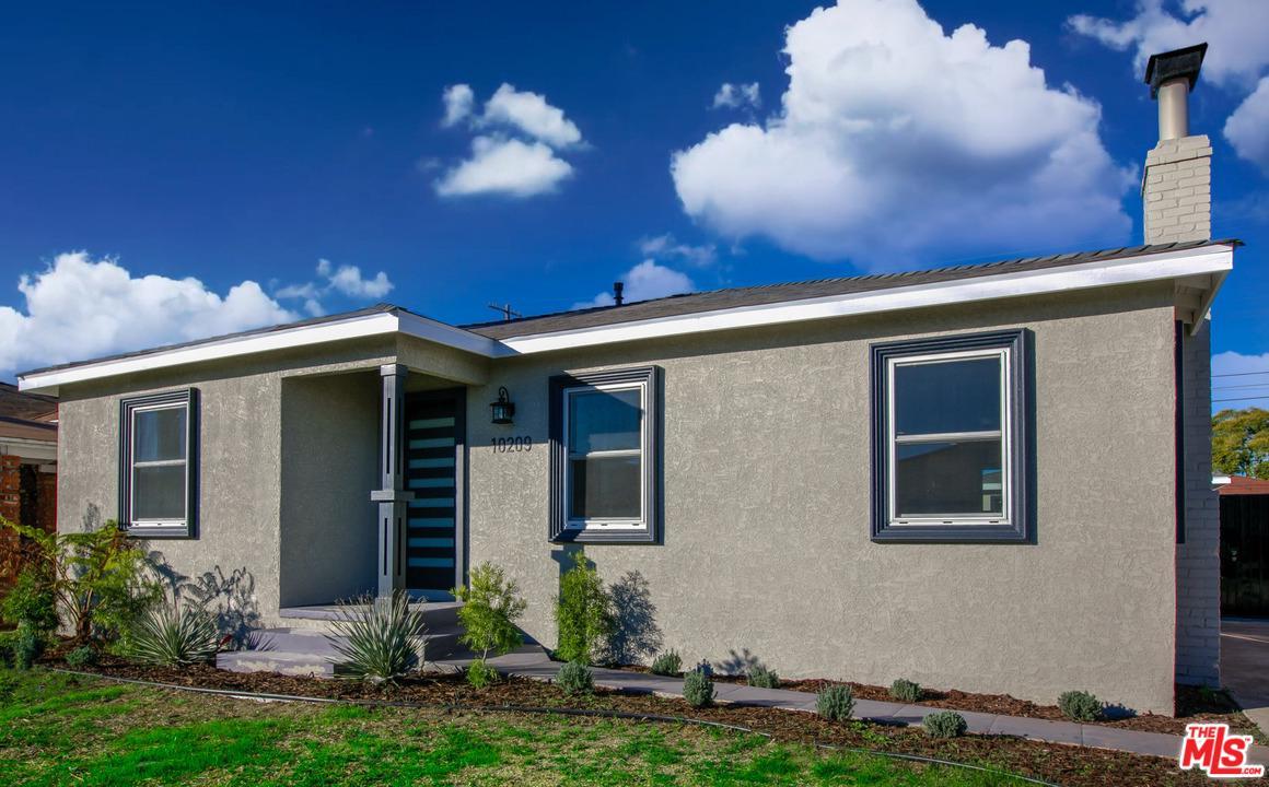 10209 South Denker Avenue Los Angeles, CA 90047