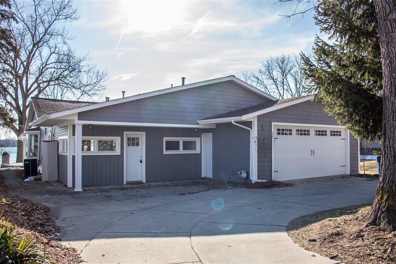 Michigan waterfront property in ann arbor whitmore lake for Pinckney garage door