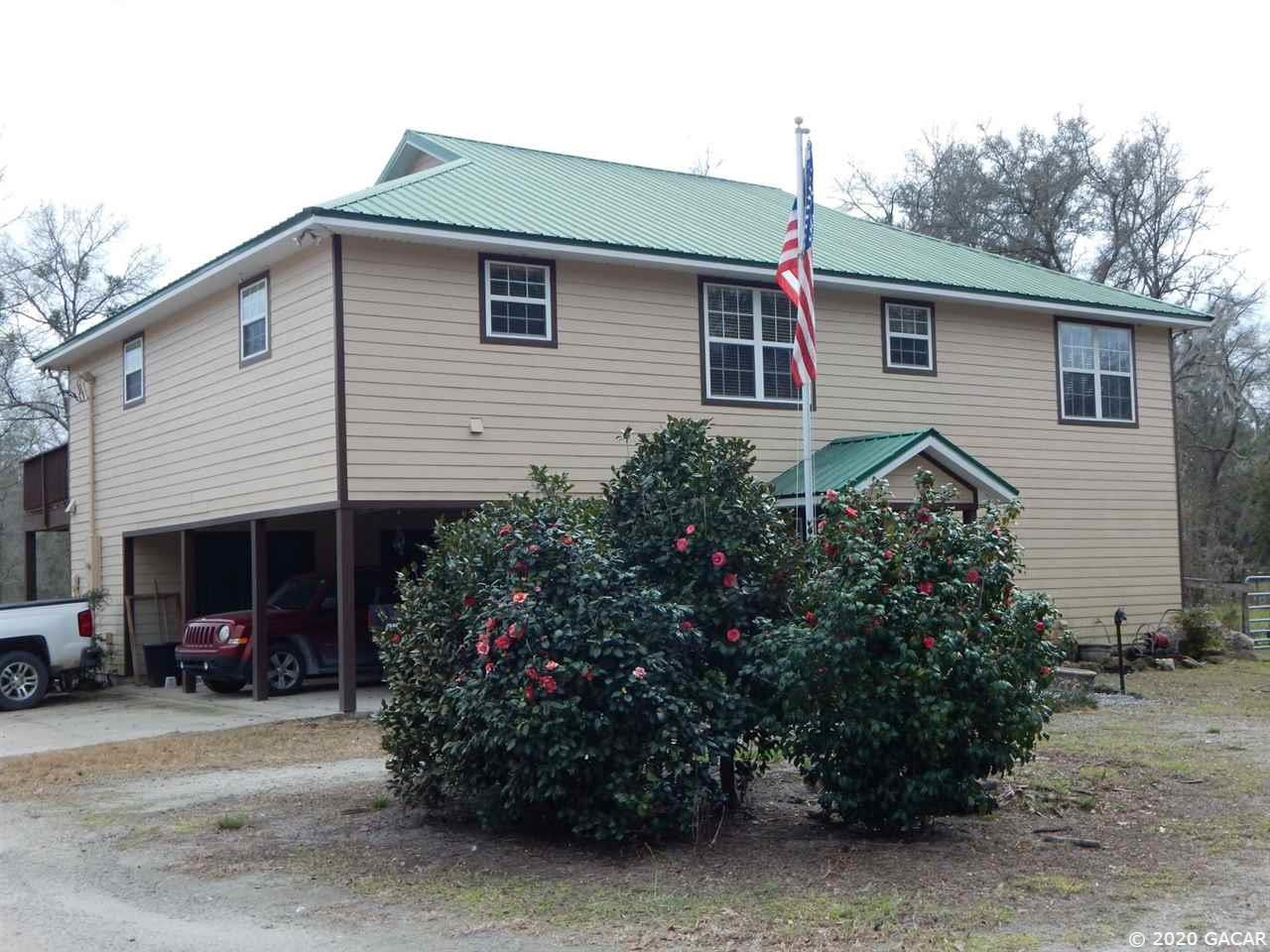 7139 NE 21ST Place, High Springs, Florida 4 Bedroom as one of Homes & Land Real Estate