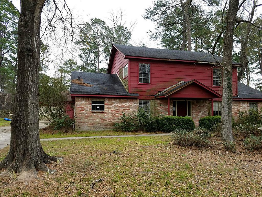 Photo of 643 Mosswood Drive  Conroe  TX
