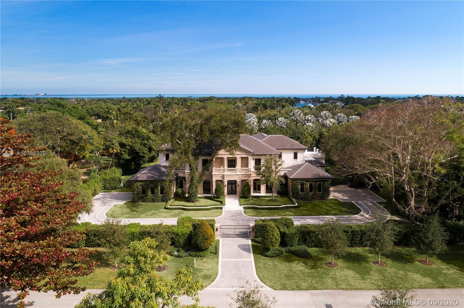 8815 Arvida Dr, Coral Gables, Florida 6 Bedroom as one of Homes & Land Real Estate
