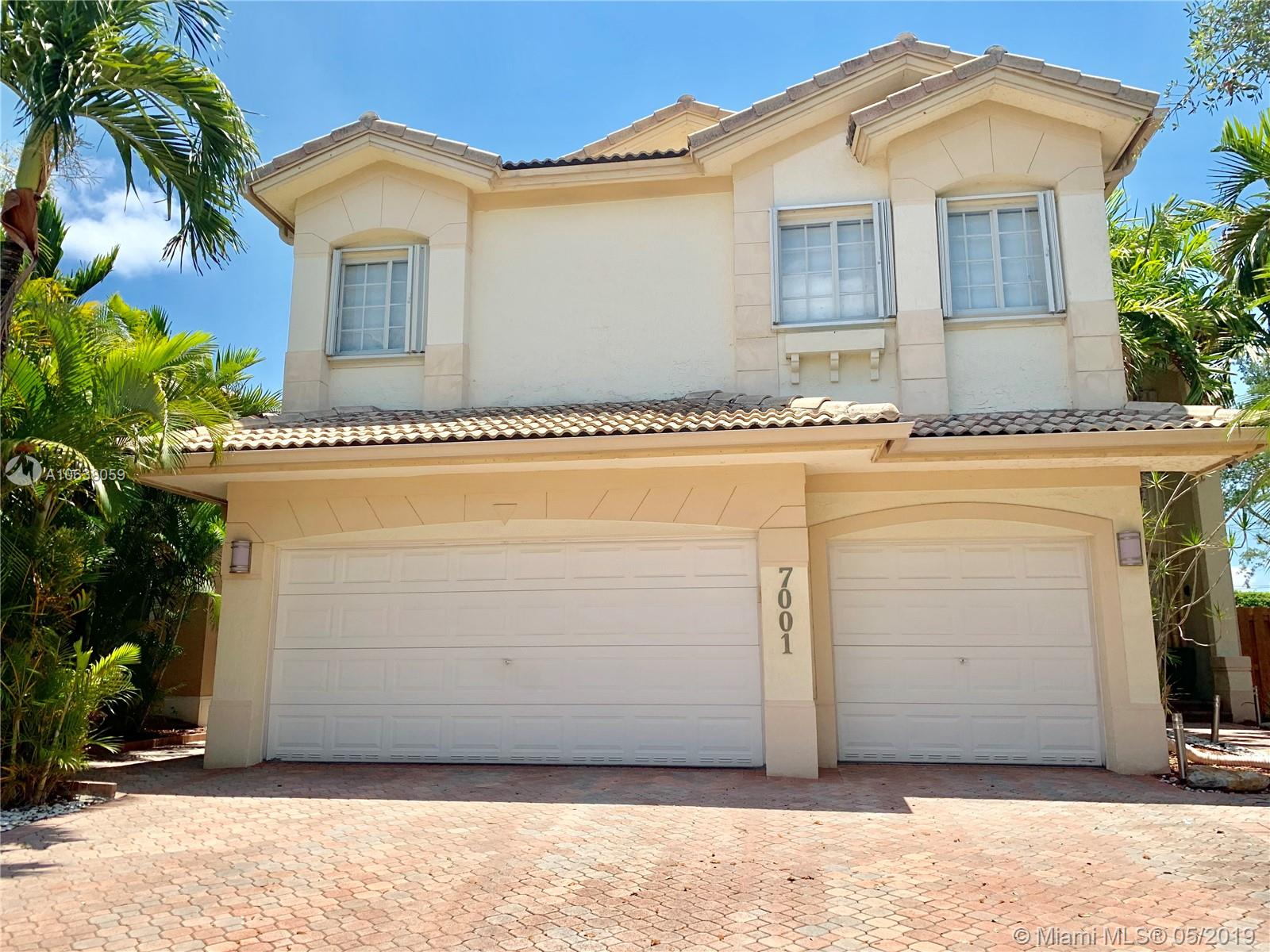 One of Doral 5 Bedroom Homes for Sale at 7001 NW 107th Ct