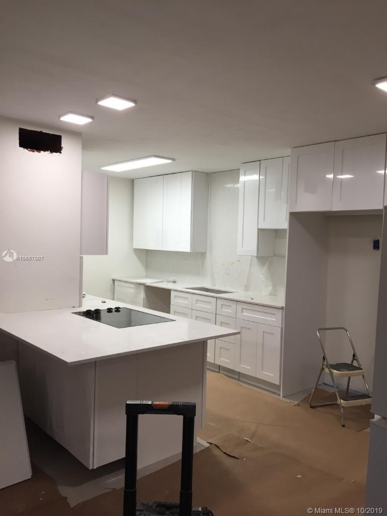 Townhome property for sale at 9350 SW 77th Ave, Coral Gables Florida 33156