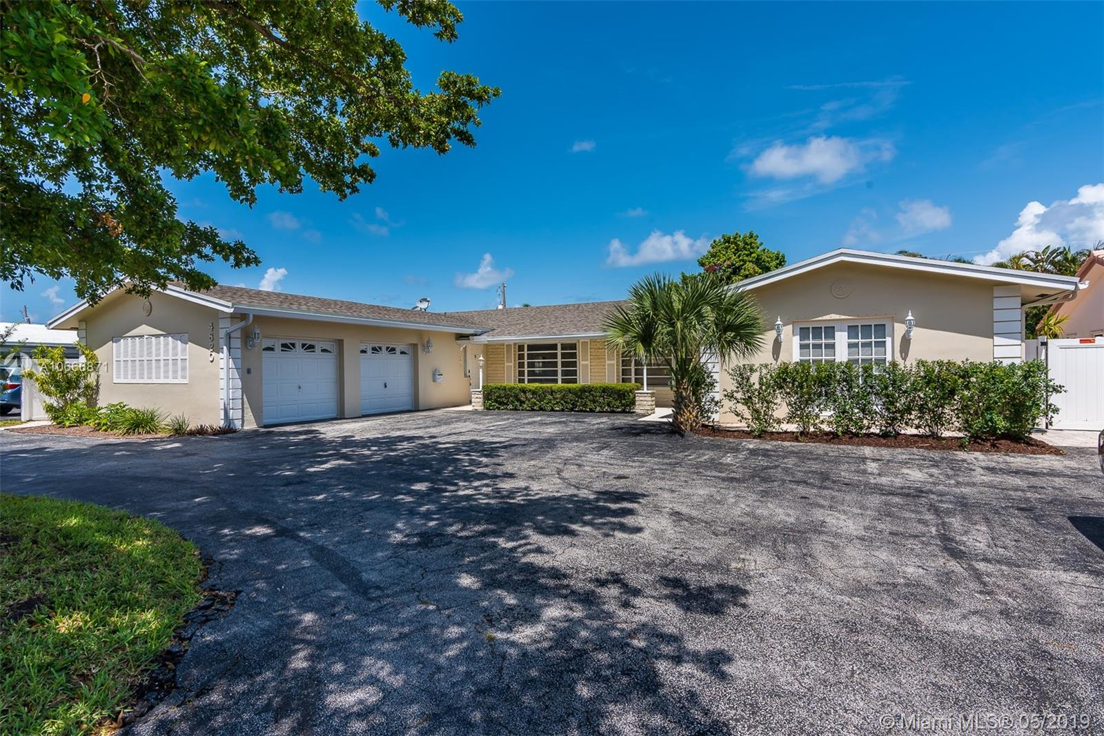 4818 NE 25th Ave, one of homes for sale in Sea Ranch Lakes