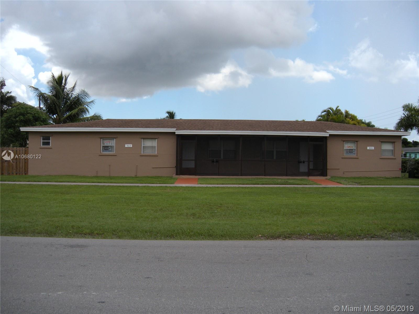One of Homestead Homes for Sale at 963 NE 2nd Ave