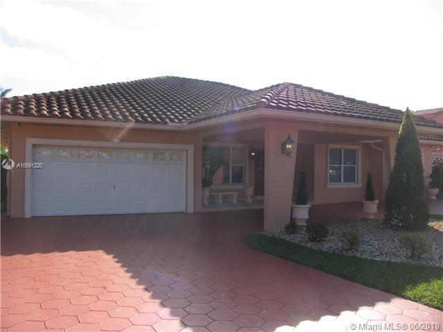 One of Kendall 4 Bedroom Homes for Sale at 3131 SW 133rd Ct