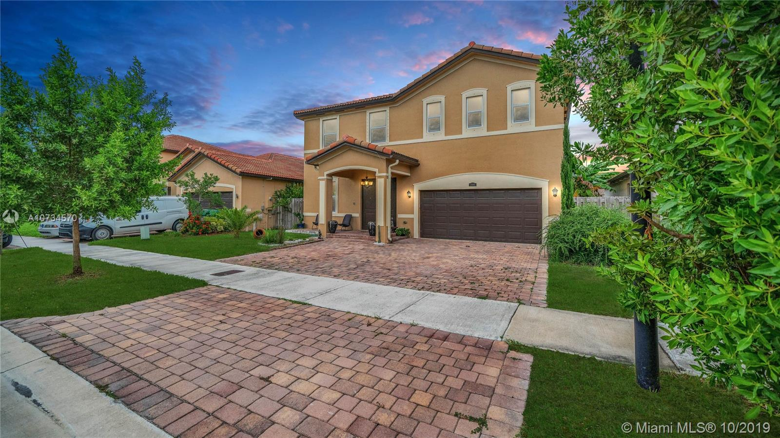 One of Homestead 5 Bedroom Homes for Sale at 25102 SW 118th Ct
