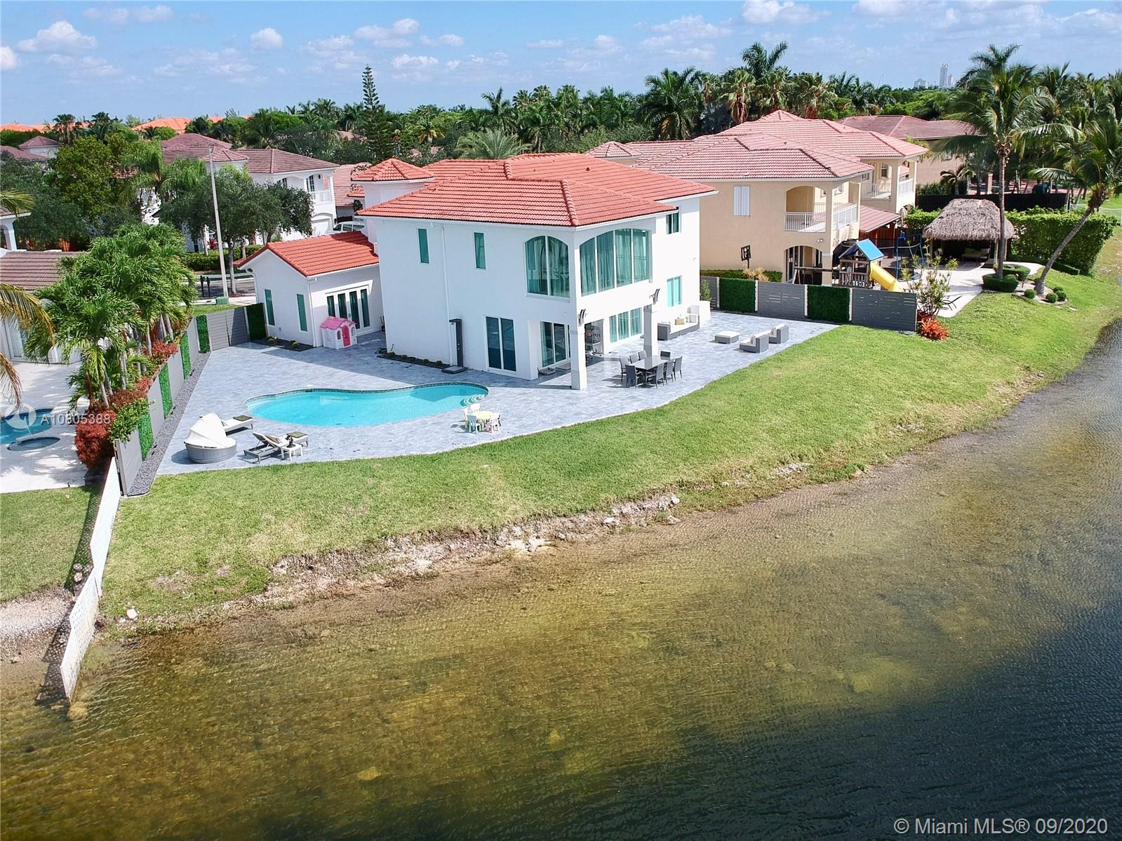 7001 NW 113th Ct, Doral, Florida 6 Bedroom as one of Homes & Land Real Estate