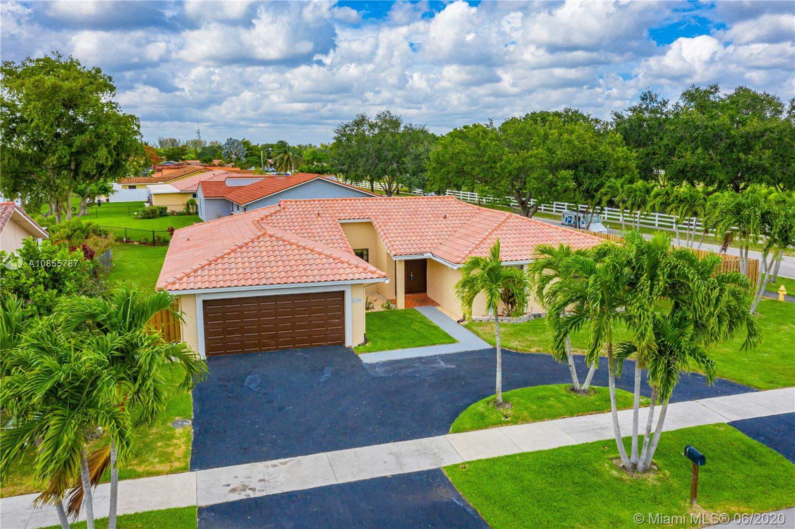 One of Cooper City 4 Bedroom Homes for Sale at 11305 SW 58th St