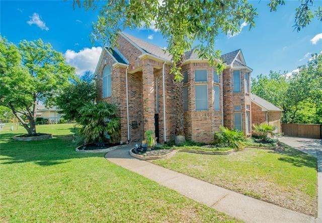 One of Highland Village 4 Bedroom Homes for Sale at 426 E Remington Drive