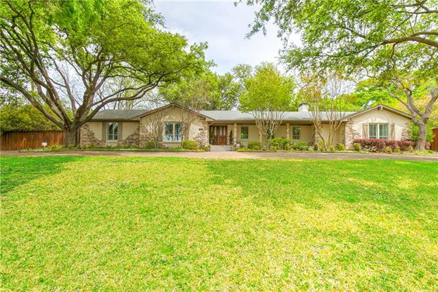 6907 Meadowcreek Drive, one of homes for sale in Addison