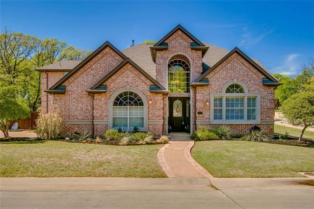 3055 Woodhollow Drive, one of homes for sale in Highland Village