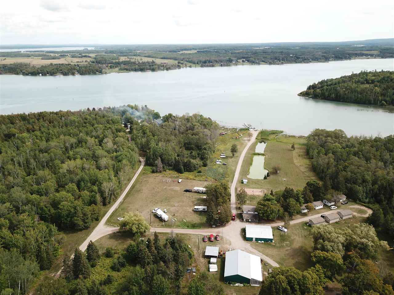 primary photo for 11550 16 1/2 Mile Rd, Barbeau, MI 49710, US