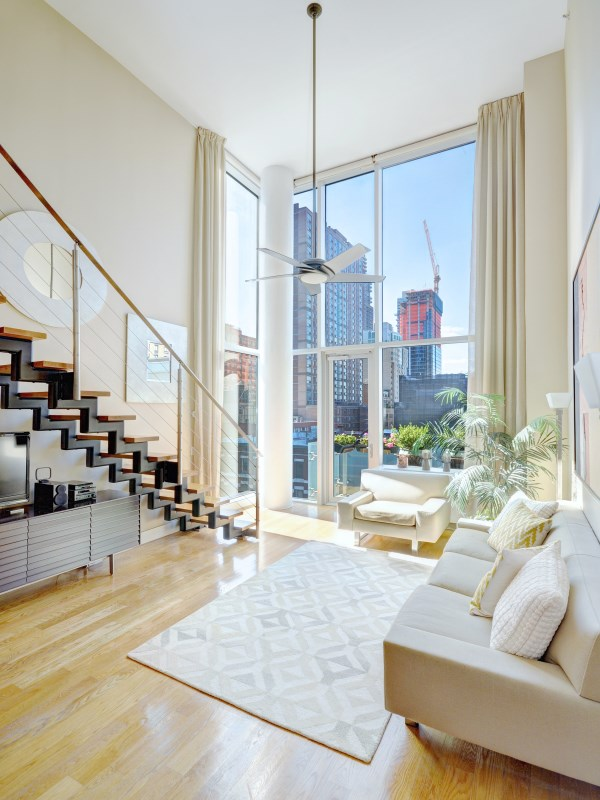 Sleek, Dramatic and Unique Penthouse