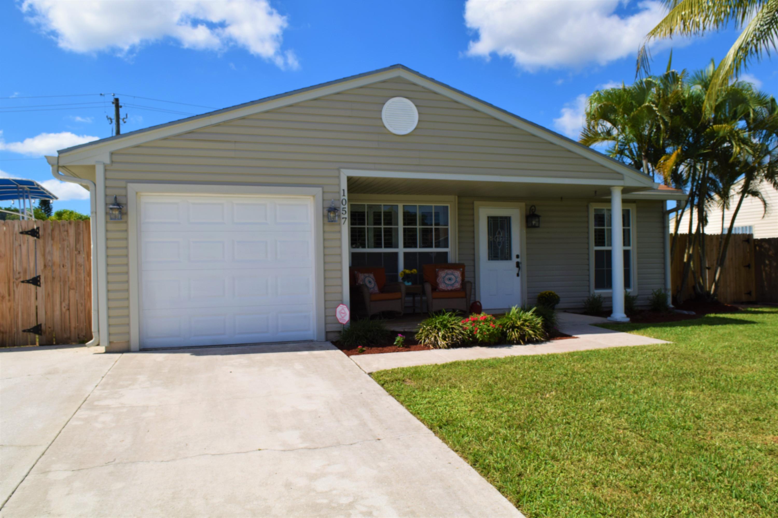 One of Royal Palm Beach 2 Bedroom Homes for Sale at 1057 Moonlight Way