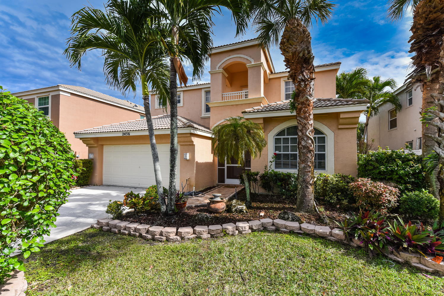 One of Royal Palm Beach 6 Bedroom Homes for Sale at 2456 Westmont Place