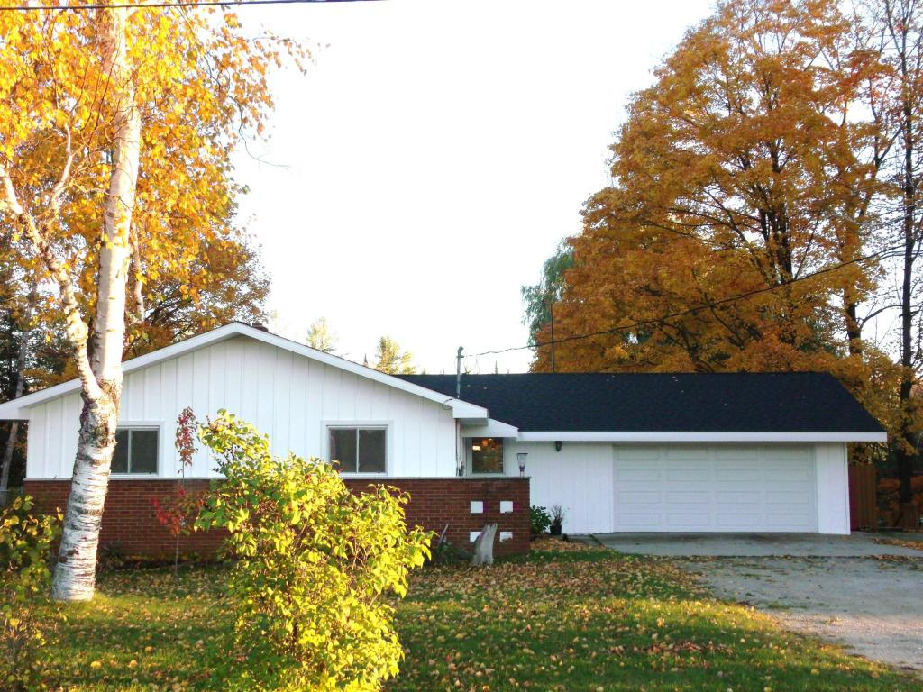 7531 Long Rapids Road, one of homes for sale in Alpena